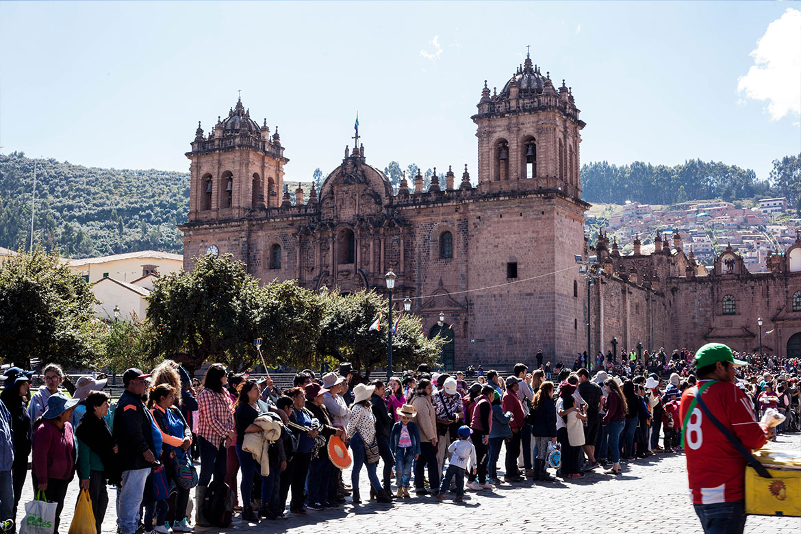 Onlookers wait for the arrival of the saints during Corpus Christi in Cusco