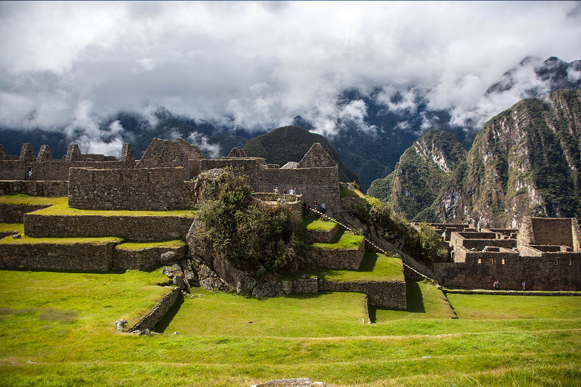 Machu Picchu ruins with view to cloud covered mountains nearby
