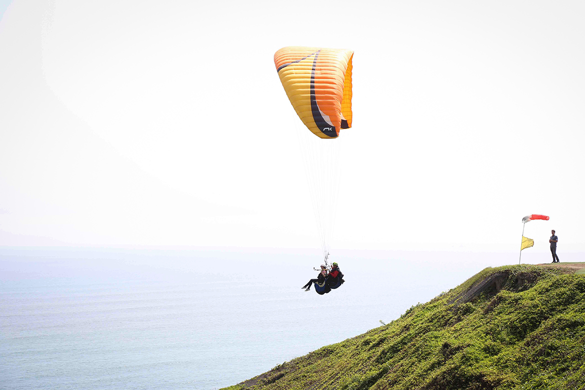 Paragliders lifting off the Lima coast