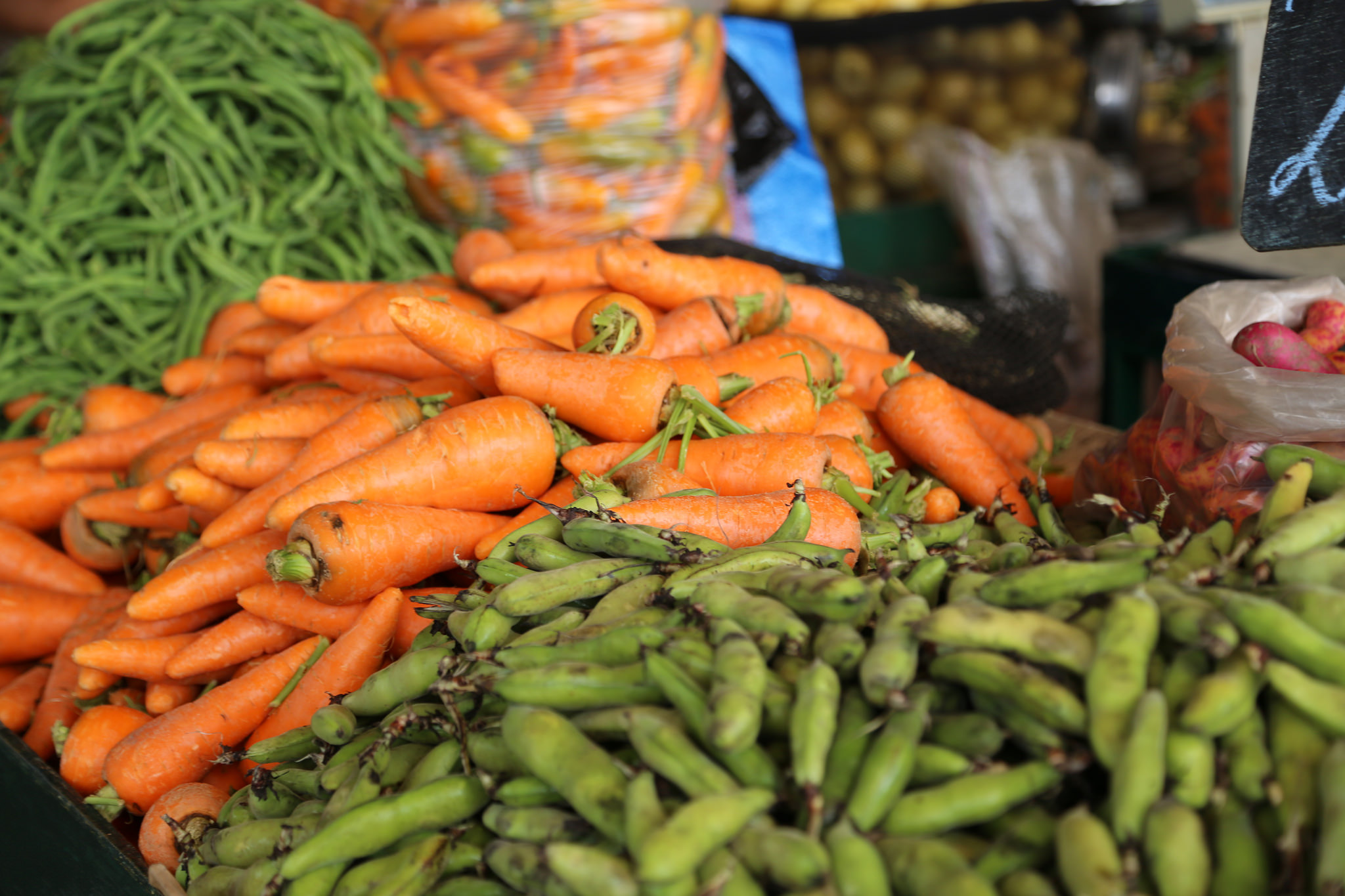 Carrots and peas at a market stall in Peru