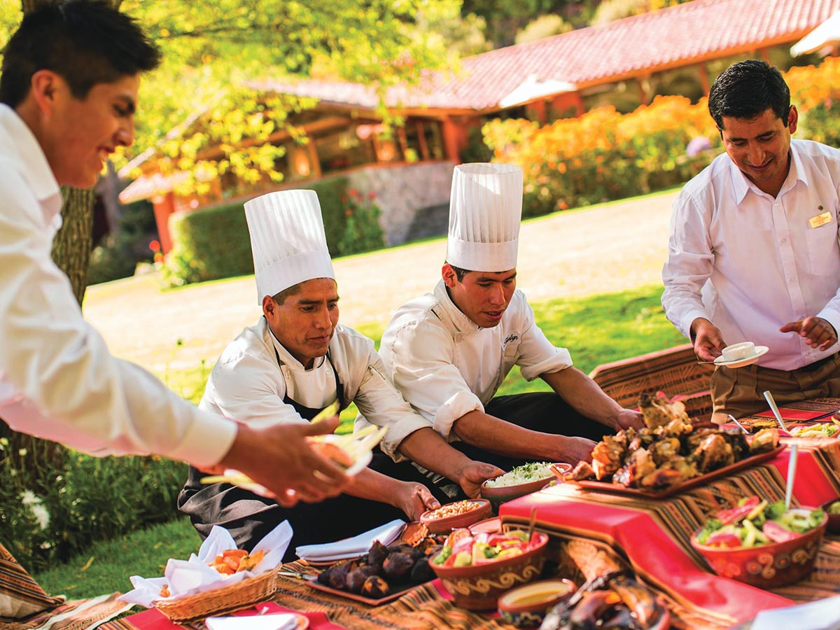 chefs preparing the pachamanca dishes and fresh salad to eat