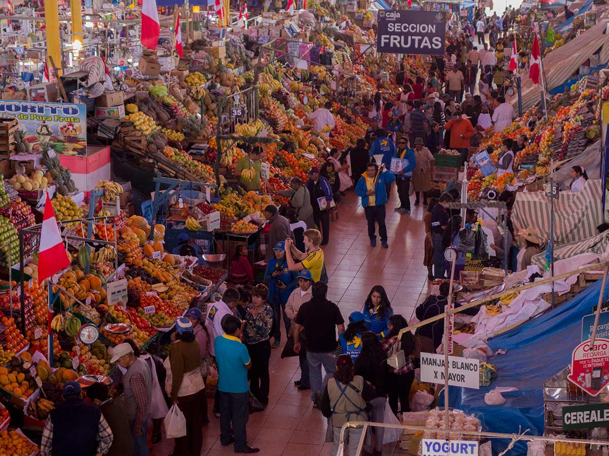 Stalls at san camilo market in Arequipa filled with piles of fruits and vegetables