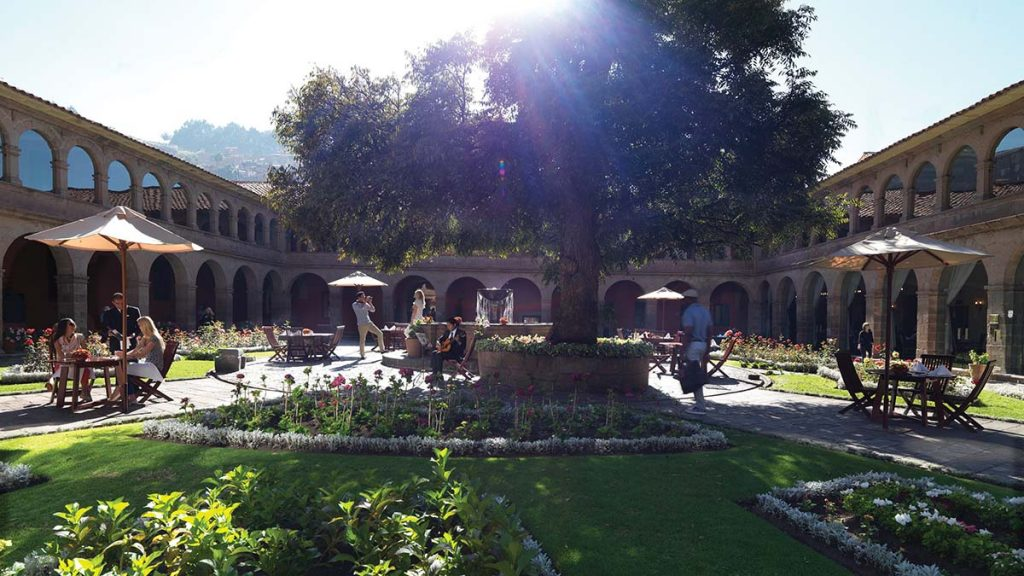 The central courtyard and rose gardens at Belmond Hotel Monasterio, one of the best hotels in Cusco.