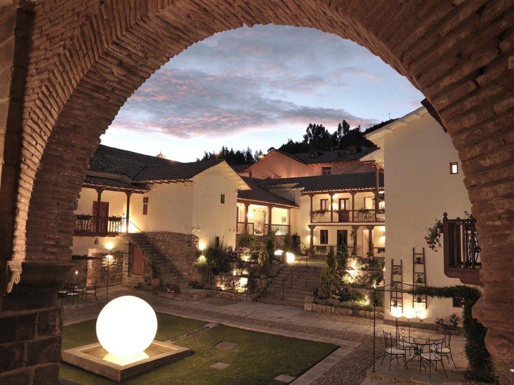 The view of Casa Cartagena's minimalist grass courtyard at dusk.