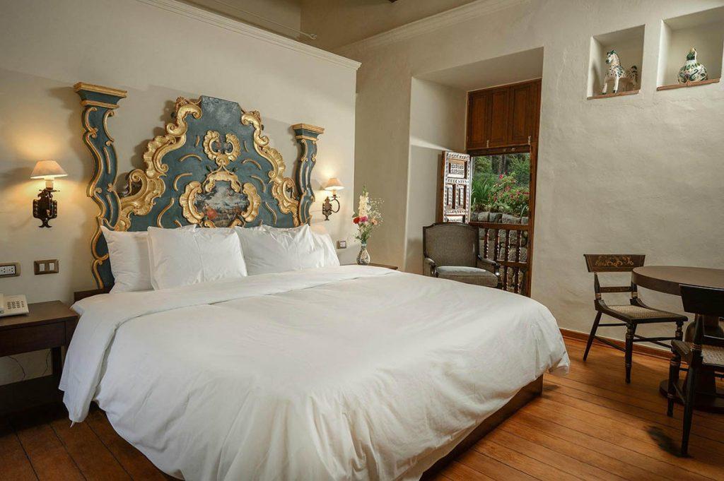 Hotel Palacio Manco Capac's Balcony Suite and view of the delightful gardens.