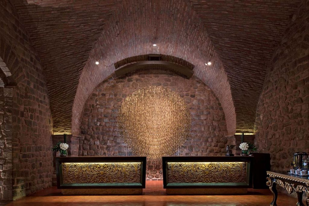 The lobby and Inca stonework walls at JW Marriott Cusco.