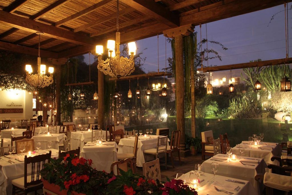Romantic lighting and white table cloths of Cafe Larco with large windows overlooking the garden makes for a perfect honeymoon dinner.