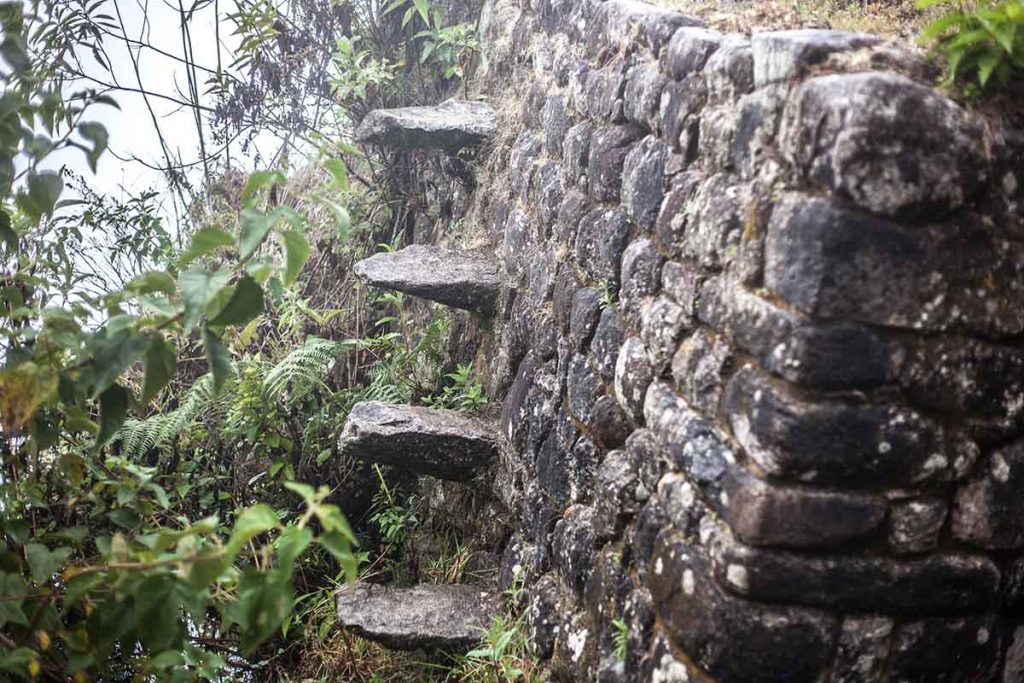 An example of the stone steps that the Incas use to reach their terraces. The steps jut out of an Incan stone wall.