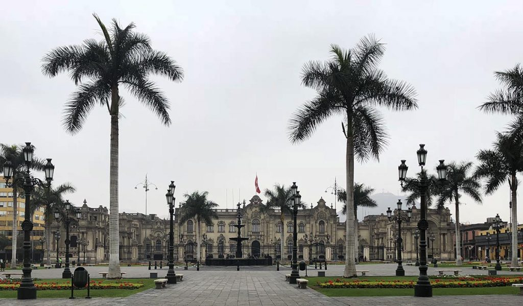 Lima's palm tree lined Plaza de Armas. The government palace is in the far background.