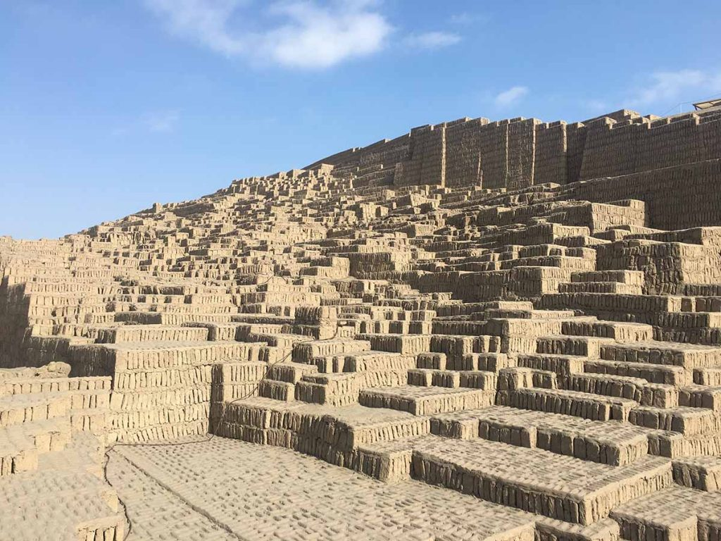 The adobe and clay brick walls of urban Lima's most famous archaeological site, Huaca Pucllana.