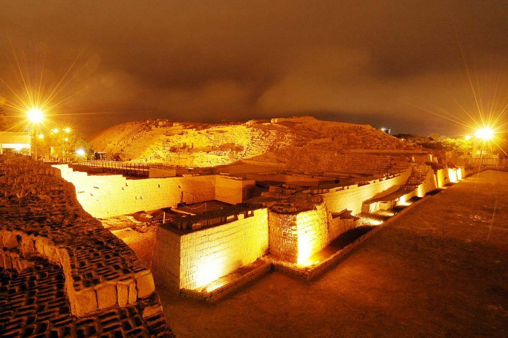 Huaca Pucllana, the ancient pyramid in Lima, lit up at night.