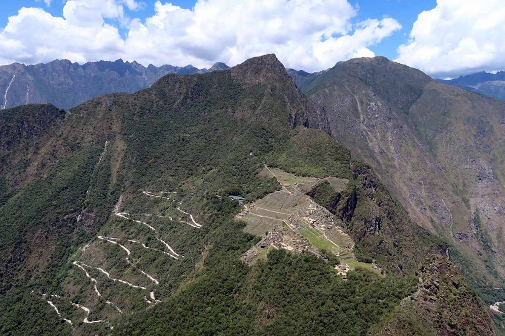 The view of Machu Picchu and the surrounding mountains from the top of Huayna Picchu on a clear day.