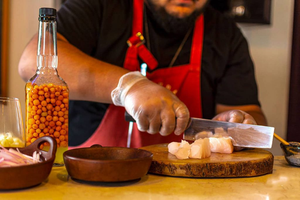A chef prepares ceviche during a Peruvian cooking class in Lima.