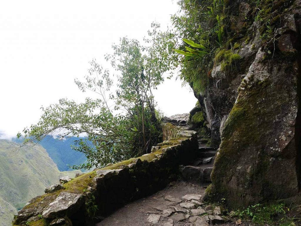 The hiking trail constructed by the Incas that leads to the Inca Bridge. The stone steps are narrow and directly beside the cliff.