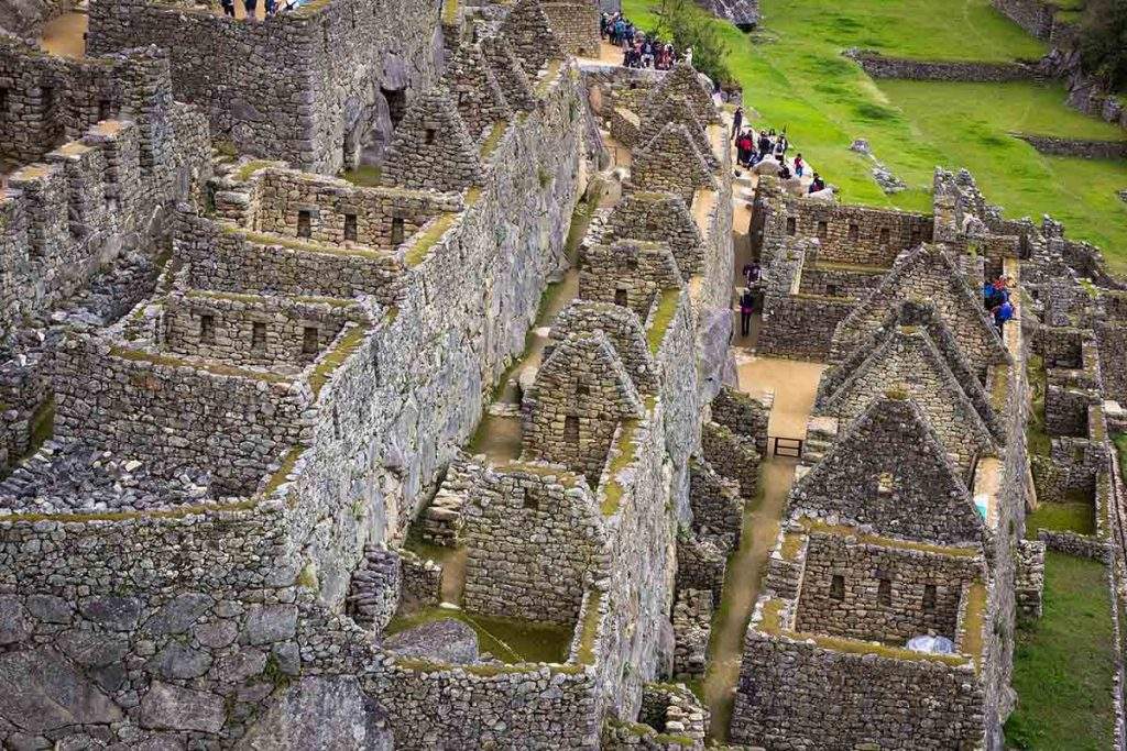 A zoomed-in photo of the main ruins in Machu Picchu. The Inca stonework is visible including the perfect walls and windows.