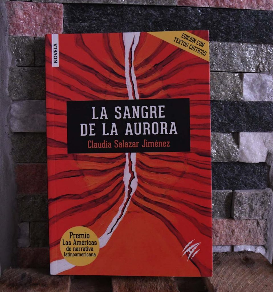 """The cover art for Claudia Salazar Jimenez's """"Blood of the Dawn"""" features an orange-red background with black lines emanating from a white chasm through the middle."""