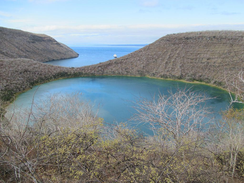 a small blue-green lake separated from the ocean by a narrow isthmus