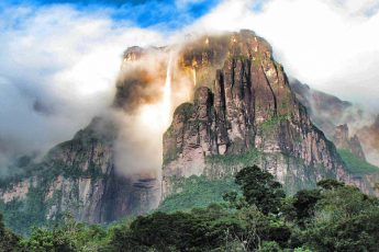 A beam of light illuminates the cascading Angel Falls in Venezuela.