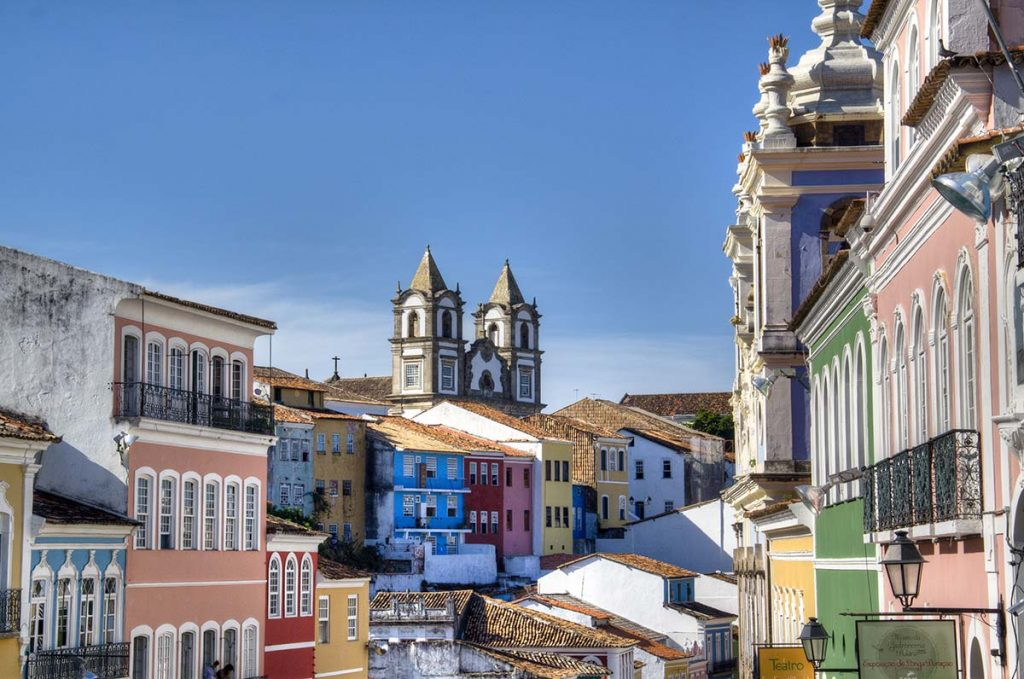 Many closely packed buildings are shown with different paint colors. The architecture is older and unique to the Pelourinho district in Salvador.