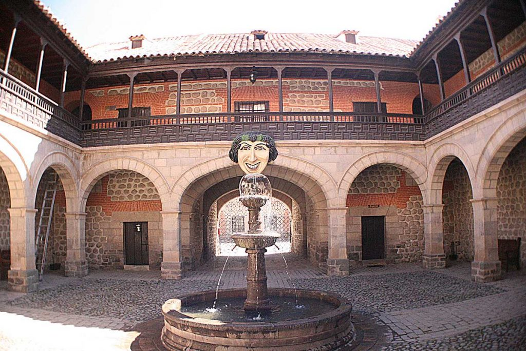 An elaborate fountain sits in the center of a stone courtyard in Potosi, Bolivia.