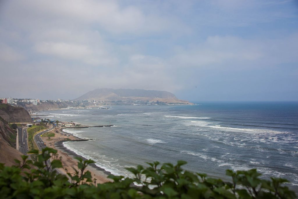 Hazy view of the Pacific coast and highway from Lima's Malecón.
